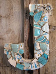 Mosaic letter J in Tiffany blues with large rhinestone brooch.