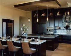 Contemporary kitchen with dark cabinets and light countertops