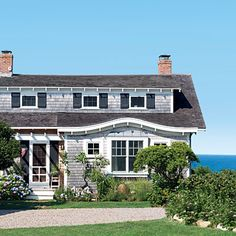 This charming cottage backs up to the expansive waters of the Atlantic Ocean. | Coastalliving.com
