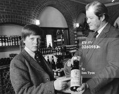 Caption: 9th September 1977: Charles Spencer, Viscount Althorp, (left), aged 13, only son of the 8th Earl Spencer, (right), in their cellar at Althorp House, Northamptonshire, with some of their own wine, which is available to the public. The Viscount's older sister Diana later became the Princess of Wales. (Photo by Ian Tyas/Keystone Features/Getty Images)