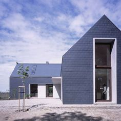 The cross-shaped building has four wings and is based on pre-war farm buildings typical of the area, near Wroclaw in Poland. Contemporary Barn, Modern Barn, Residential Architecture, Modern Architecture, Isolation Facade, Facade Design, House Design, House Cladding, Barns Sheds
