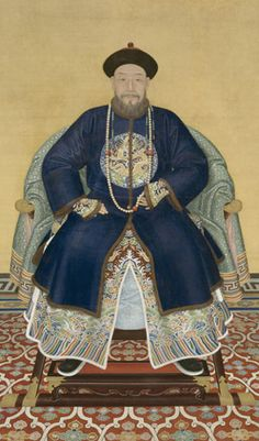 Portrait of Prince Hongming (1705-67 AD).  The prince wears semiformal, winter court dress. The dragon badge on his coat announces his court rank, and the open side vents reveal drawstring pouches and a white scarf hanging from his belt on both left and right. These are typical male costume accessories worn during the Qing dynasty.