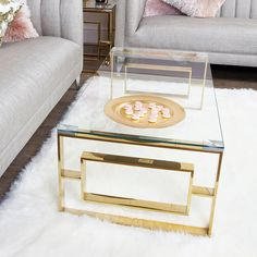 Bring a glamorous touch to your living room with the Plaza Gold metal coffee table. Crafted in a steel frame, it showcases a golden hue and a rectangular design on the table ends with a tempered clear glass table top. Clear Coffee Table, Coffe Table, Table Decor Living Room, My Living Room, Cream And Gold Living Room, Room Decor, Contemporary Coffee Table, Modern Coffee Tables, Contemporary Style
