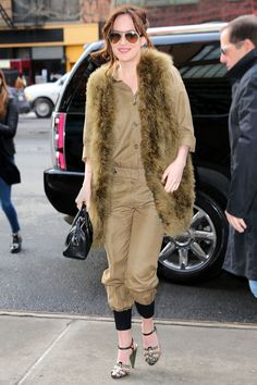 Who: Dakota Johnson What: A Military Inspired Jumpsuit Why: The actress looks laidback and very chic in a utilitarian inspired flight suit, paired with a textural vest in the same shade for lesson in monochromatic dressing.     Get the look now: Etoile Isabel Marant jumpsuit, $715 barneys.com   - HarpersBAZAAR.com