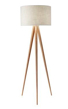 Set below a classic drum shade, this eye-catching floor lamp features a splayed tripod base composed of richly figured rubberwood.