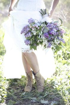 A lush bouquet of lilacs and succulents designed by Intertwine