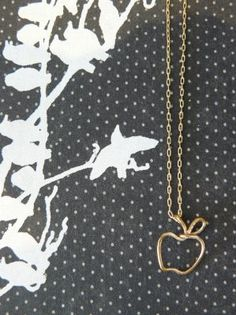 i'm in the market for a cute little apple charm necklace. too cheesy for a teacher?