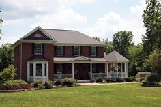 A wrap around porch along the front of this #home
