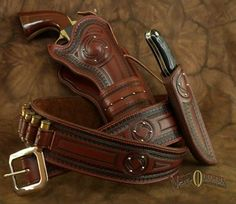 This elegant rig is the perfect choice for your fine sidearm. Made to fit any single six pistol and knife. Price includes 18 loops and shipp. Old West, Custom Leather Holsters, Western Holsters, Westerns, Cowboy Action Shooting, Pistol Holster, Leather Tooling, Leather Bags, Leather Projects