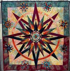 mariner's compass quilt | Mariner's compass/star quilt; lovely interpretation | Quilts