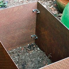 Planter used 4 pieces of rusted steel with a diamond-plate pattern, cut to size at the metal yard, make up each of the four planter boxes. The tallest one measures 2½ feet high by 2½ feet wide by 2 feet deep. Brackets Galvanized L-brackets, mounted with screws on each inside corner as shown, hold the boxes together. We drilled holes with a titanium oxide bit. Time and cost The material for all four boxes cost $250, and two people spent two days shopping for and building the project. THE…