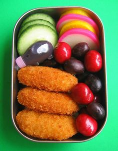 "Tonkatsu (fried breaded pork), cucumber, cherries, grapes, tonkatsu sauce (almost like worcestshire), asian pickles, ""fish cake"""