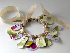 Charm bracelet made of cardstock Mod Podged with rice paper that has leaves pressed into it -- simple and beautiful!