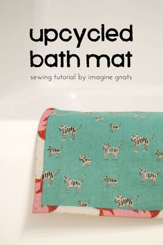 use an old towel to make a new bath mat!