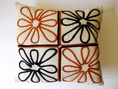 Every mid-century home could use an extra sprinkling of orange or avocado green. Love the simple embroidery. [Mid Century Modern Decorative Embroidered Pillow by The White Mole, via Flickr]