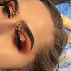 "✨✨HOLIDAY GLAM✨✨ BROWS: @anastasiabeverlyhills dipbrow in medium brown EYES: @tartecosmetics tarteist lip paint in ""juicy"" as red base; @anastasiabeverlyhills @norvina modern renaissance palette using burnt orange as transition, love letter and red ochre to deepen blend; @morphebrushes 35C palette red tones; loose gold pigment is ""skinny dip"" lip kit from tattoojunkie; lashes are halloween walmart section; gold flakes, pearls from walmart SKIN: @mariobadescu rosewater spray to prime…"