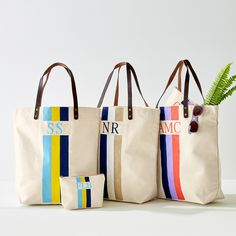 This spacious canvas carryall features leather handles and a hand-painted monogram design. Made to stand out with your wardrobe wear, the versatile essential can be used in the city or on a tropical getaway this holiday season. Painted Canvas Bags, Canvas Tote Bags, Monogram Tote Bags, Monogram Painting, Painted Monogram, Monogram Design, Diy Tote Bag, Cheap Bags, Textiles