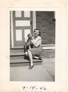 I'm such a sucker for vintage photos of people with their dogs. --> 1940s photo of woman holding a beagle.