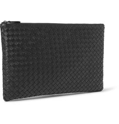 Italian heritage brand Bottega Veneta is renowned for its sleek leather accessories. This black pouch, hand-woven in the house's signature intrecciato technique, is particularly useful. Complete with a fabric-lined interior, it's sized to stow your notes and keys and can even fit a small tablet as you dash between appointments.