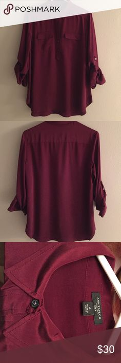 Ann Taylor Silk Camp Shirt Burgundy Pretty popover Camp Shirt from Ann Taylor.  Well made and in good condition.  Freshly dry cleaned and ready to wear.  Silk has a slightly wrinkled sand washed texture and dark buttons. Ann Taylor Tops Button Down Shirts