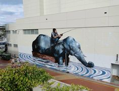 Elephant and Fisherman, Illawara performing arts centre, Wollongong. | 27 Jaw Dropping Works Of Street Art So Big They Will Never Fit In A Gallery
