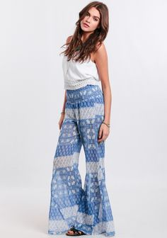 Create the perfect boho ensemble with these chiffon pants featuring a blue and white vintage-inspired floral and global print medley.