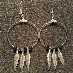 Magnifique paire de boucles d'oreilles en acier inoxydable argenté