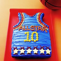 "All Star Birthday Cake..Bake the cake in a 9 x 13 "" pan, trim up top as shown in the picture, ice it, and decorate Includes a video for variations on design."