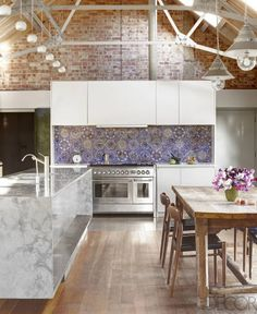 Brick and patterned tile in the kitchen