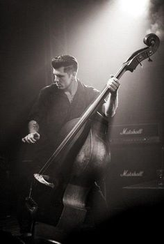 Look at how attractive this bass player is... o.o