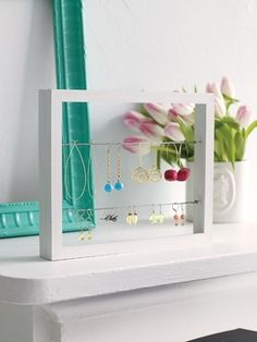 box frame, wire and eyelet hooks. Very contemporary looking jewelry display with very clean lines.