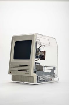 https://flic.kr/p/phN8da | Macintosh SE with clear display case | Not much is known about this. It appears to be a sales tool for the Macintosh SE. The only label on it states: CAUTION!!! Computer must NOT  be connected to power source while display case is installed, since EMI emissions may occur. This product is not FCC approved, and should only be used for display purposes ONLY.