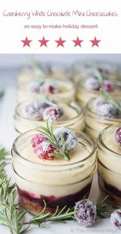 These delicious White Chocolate Mini Cheesecakes are perfect for holiday entertaining. They have a cookie crumb crust, an easy to make cranberry jam layer, and the creamiest cheesecake that's lightly flavored with white chocolate. Baked in mini canning jars, they look great on the table and transport easily. You will LOVE these!   theendlessmeal.com   #christmasbaking #holidaybaking #cheesecake #dessert #minicheesecakes #christmasrecipes