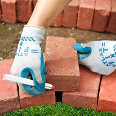 How to make angled keystone bricks to fill the triangular gaps in the curves of your garden bed edge