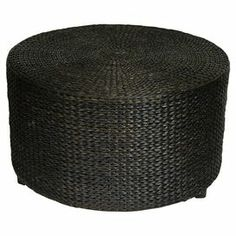 """Woven rush grass coffee table with a drum silhouette.       Product: Coffee table    Construction Material: Woven rush grass    Color: Black      Features:   Simple and beautifully crafted    Lightweight, practical home accessory   Can also be used as a table        Dimensions: 16.5"""" H x 30"""" Diameter"""
