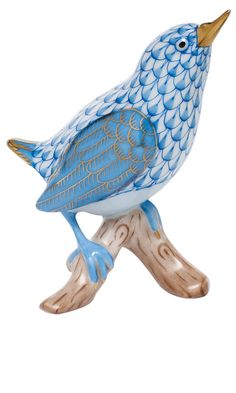Herend, Hungary Hand Painted Porcelain Figurine of Bird with Head High Sitting on Branch, in Blue Fishnet with Gold Accents.