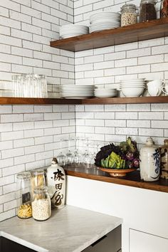 Love the glazed brick tiles and walnut shelves. photos by lincoln barbour Loft Kitchen, Eclectic Kitchen, Kitchen Corner, Kitchen Shelves, Kitchen Tiles, New Kitchen, Cupboards, Kitchen Brick, Kitchen Unit
