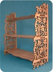 """Full size patterns for scroll saw detailed floral designs grace the side supports of this curio / book shelf. Stands 17"""" tall finished. Beautiful eye catcher. A list of materials will be email"""
