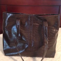 """Brown Tote Patterned Brown Tote. 16"""" wide by about 12"""" tall. One zipper pocket on inside. Some wear on straps as shown in last picture (some of the stitching has come out of the seam on one side of the strap). Inside of bag is in perfect condition. Bags Totes"""