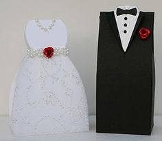 These are adorable! DIY Tuxedo and Gown Wedding Favor Boxes from: Creative Cuts and More. (you need to assemble them and add your own embellishments)