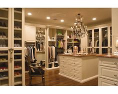 closet - love the white, the island, and the organization