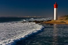Umhlanga Lighthouse in Umhlanga, KwaZulu Natal. The place of light in the 'Place of Reeds' (Zulu translation of the word Umhlanga) shines from the . South Africa Holidays, Durban South Africa, Kwazulu Natal, Holiday Places, Beautiful Waterfalls, The Good Place, National Parks, Lighthouses, Outdoor