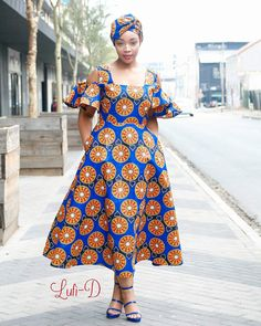 Image may contain: 1 person, standing African Wear Dresses, African Wedding Dress, African Attire, African Print Clothing, African Print Fashion, Shweshwe Dresses, Banquet Dresses, African Traditional Dresses, African Women