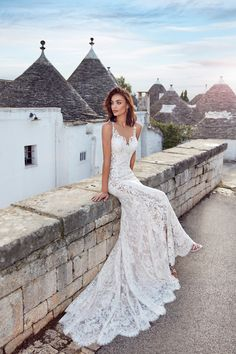 Wedding Dress Adela – Eddy K Bridal Gowns 2017 features a floral patterned lace with a peek-a-boo slit
