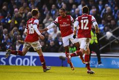 Theo Walcott celebrates the Gunners third goal during the FA Cup in 2013 with Aaron Ramsey and Olivier Giroud!