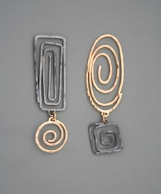 Mixed metal spiral earrings in sterling silver and gold filled, Rachel Wilder Handmade Jewelry by rachelwilder on Etsy https://www.etsy.com/listing/216987839/mixed-metal-spiral-earrings-in-sterling