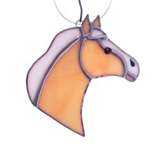 The palomino horse, western ornament or horse gift suncatcher, was cut from light tan stained glass (that has irridecent coating on the reverse side of the horse). With a white glass muzzle and mane, and black glass paint eye and nostril. ***The horse has silver solder seams, hangs from a ring, and has been waxed.  ****Approximate size: 5 1/8 (L) × 4 3/4 (W).  ***Although I try to be as accurate as possible when I take pictures, there may be a slight variation in color.  *** Please keep in…