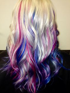 Platinum blonde hair with blue, pink and purple streaks