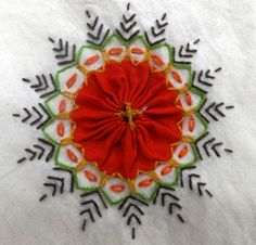 """Carolyn Foley of Caro-Rose-Creations is sharing photos of a Sri Lankan tablecloth in her collection. She says, """"There are a lot of Indian elements in this piece of embroidery but it is still typically Sri Lankan."""" The artist used just a few simple stitches, but the combination of detail, geometry, and color is striking and luxurious."""