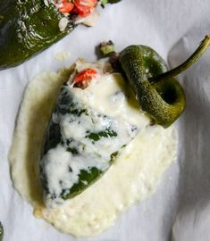 Cheese Smothered Stuffed Poblanos - a smokey and cheesy that makes the perfect appetizer for any party. Mexican Dishes, Mexican Food Recipes, Vegetarian Recipes, Cooking Recipes, Vegetable Recipes, Healthy Recipes, Tostadas, Tacos, Stuffed Poblanos